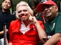 Video: Richard Branson dresses up as air hostess after losing bet