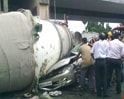 Video: Car crushed as cement mixture truck falls from flyover
