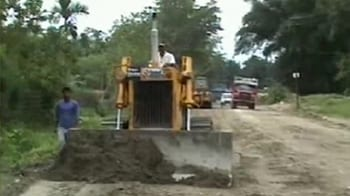 Video : In Assam, a road being built through a reserved forest