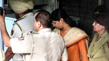 Video : In court today, stoic Kanimozhi manages a smile
