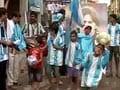 Kolkatans draped in blue and white
