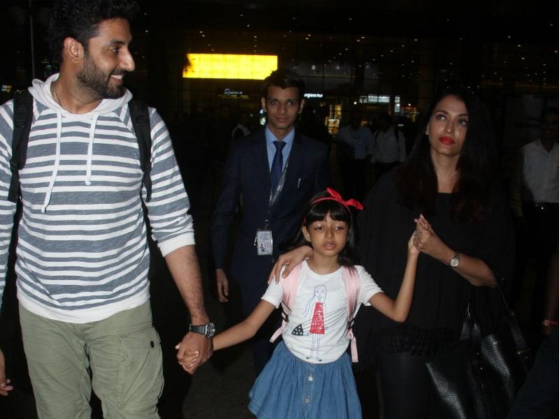 Abhishek, Aishwarya and Aaradhya Touch Down In Mumbai
