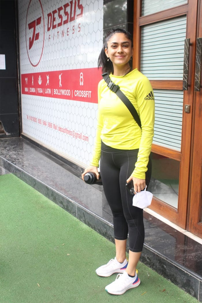 Mrunal Thakur posed happily for the shutterbugs outside her gym.