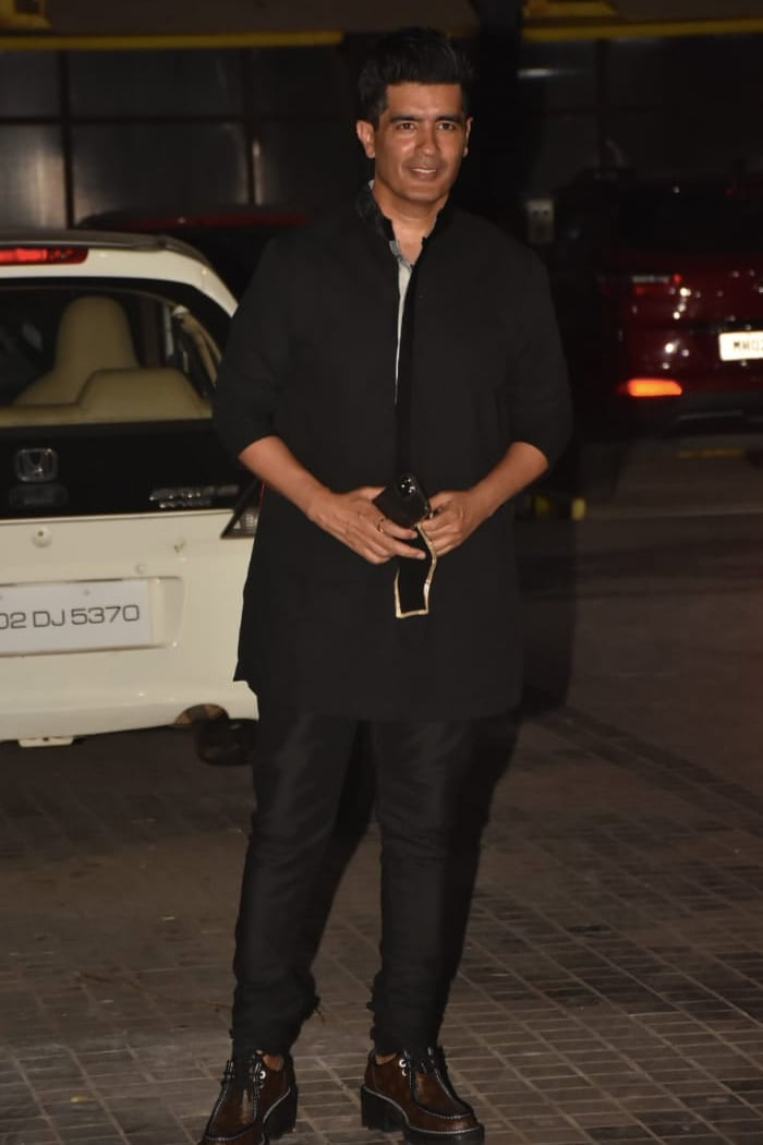 Manish Malhotra attended at the party in all-black attire.