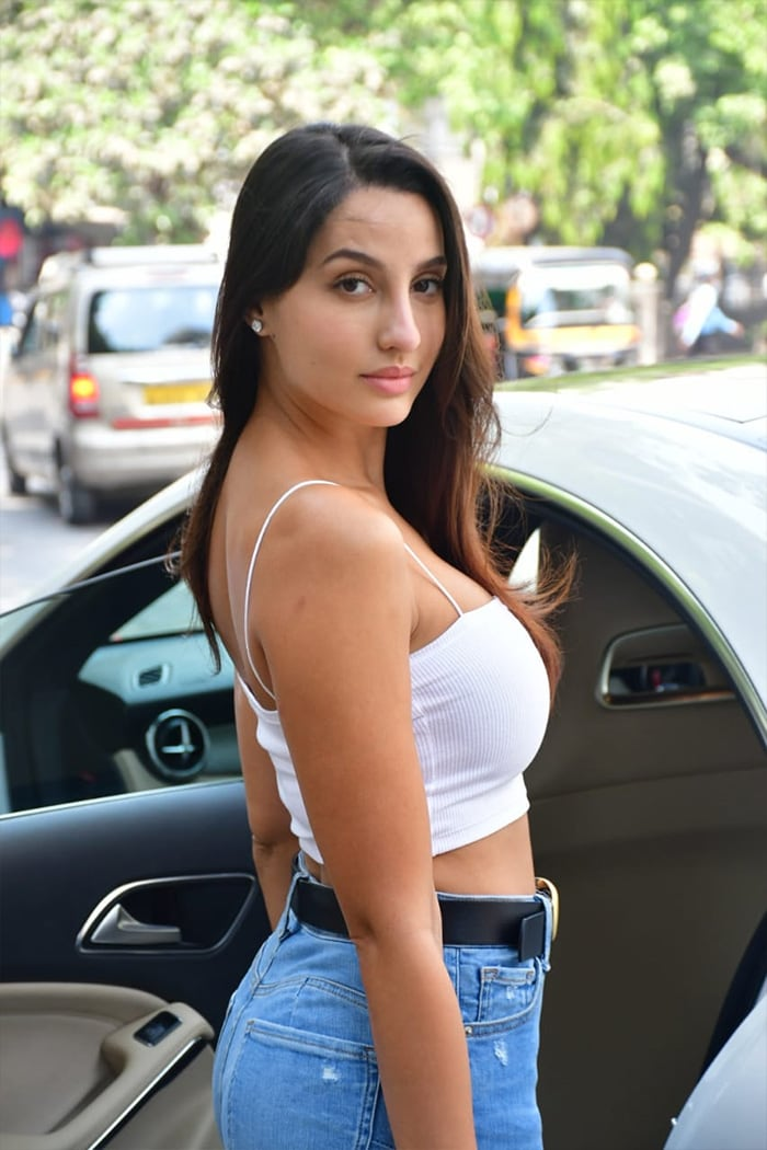 Nora Fatehi looked stunning as she posed outside the Muah salon.