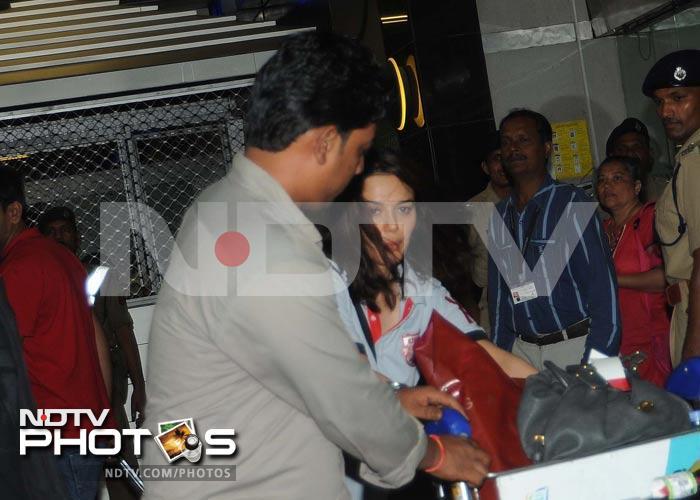At the airport: Solemn Gauri, peek-a-boo Preity