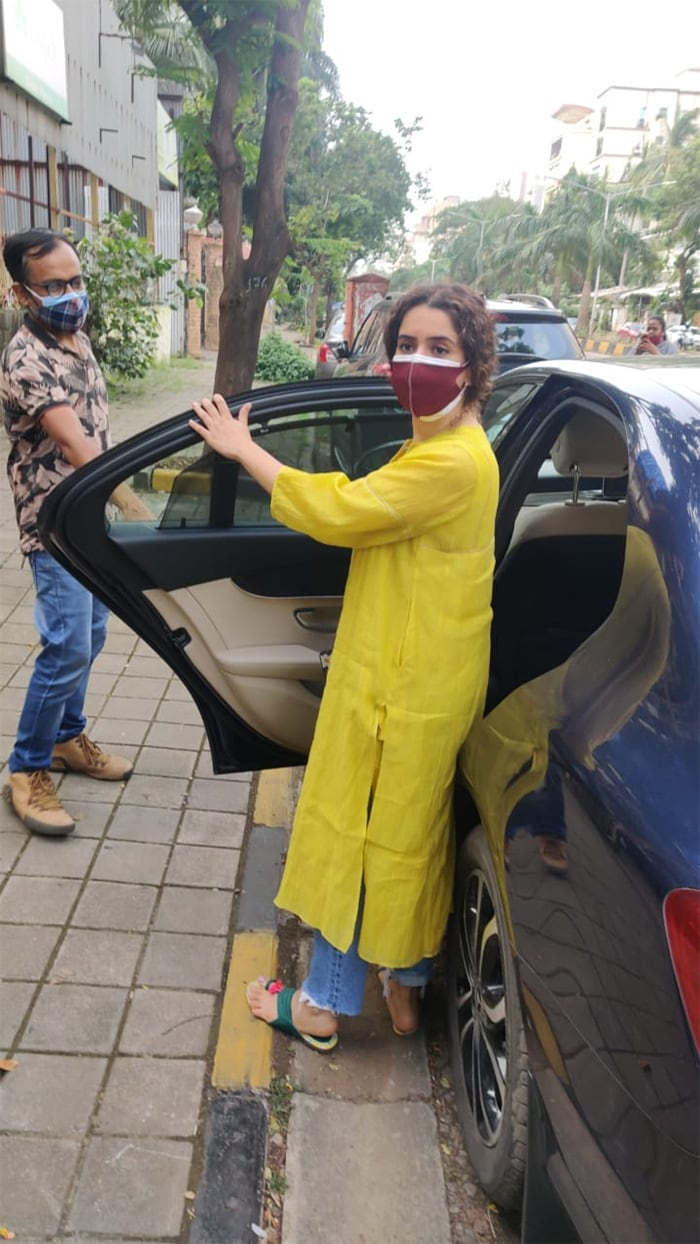 Sanya Malhotra picked out a yellow outfit as she stepped out to visit a salon in Juhu.