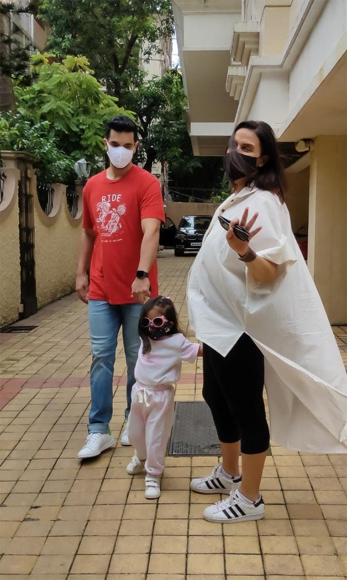 Neha Dhupia was pictured with her husband, actor Angad Bedi, and daughter Mehr in Bandra.