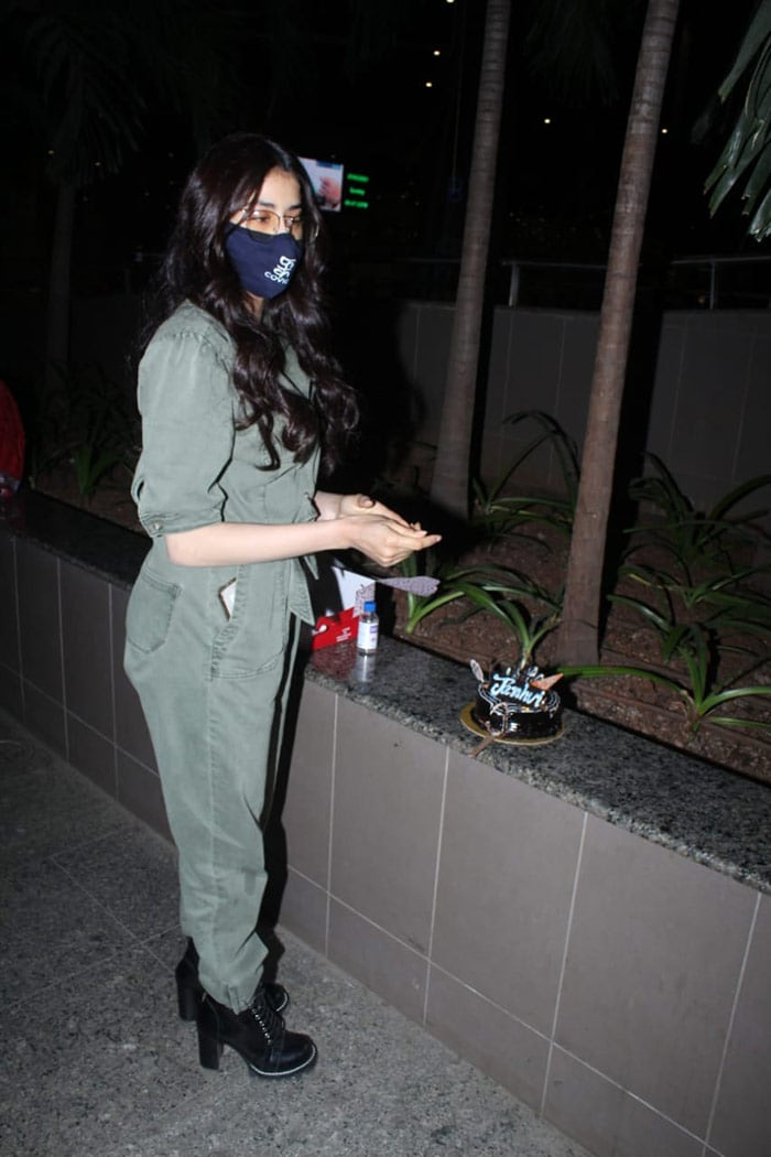 She celebrated her birthday with mediapersons present at the airport.