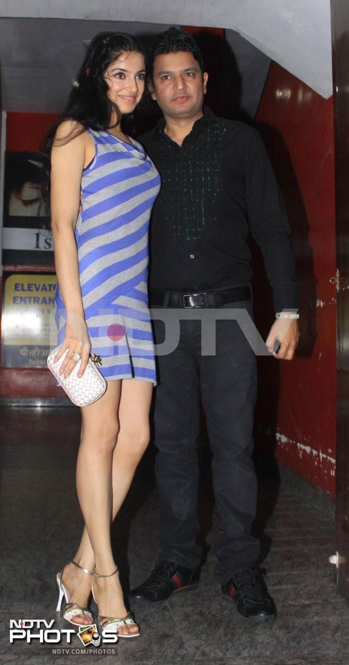 John takes fiancee Priya to a movie