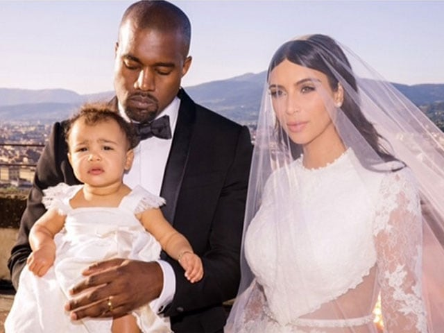 Just Married Kim and Kanye With Baby North