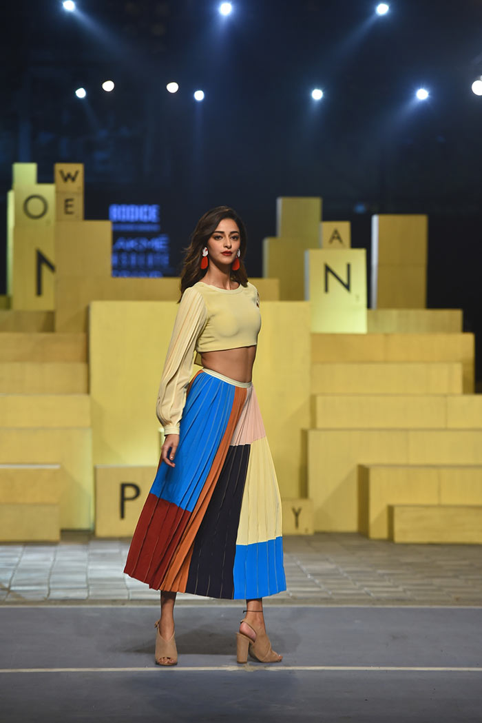 She wore an easy breezy yellow balloon-sleeved crop top with a multi-coloured flowy skirt for the grand finale.