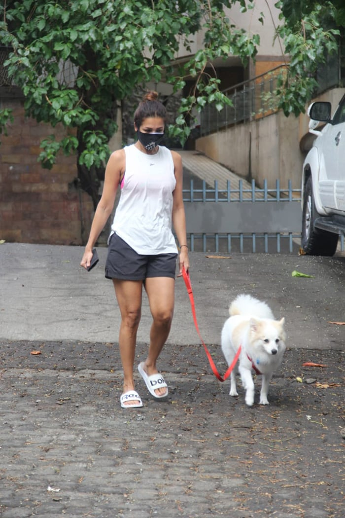 Actress Malaika Arora was on Thursday spotted taking a walk with her dog in Bandra.