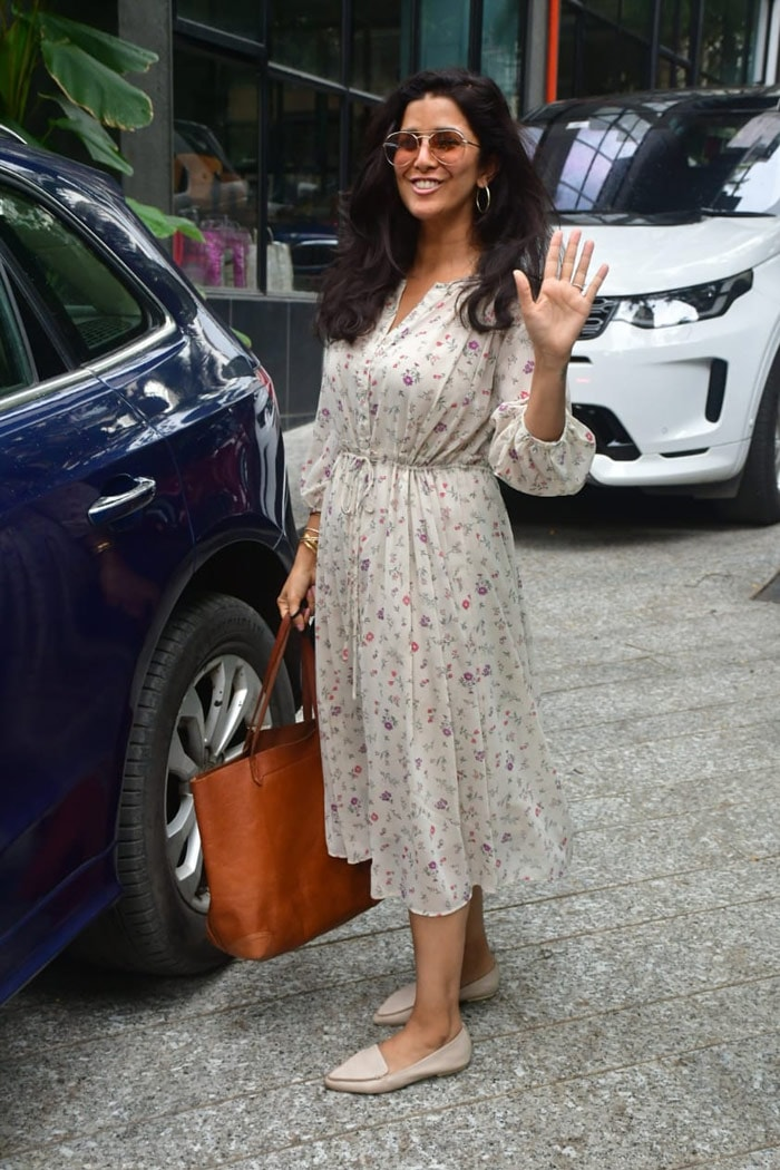 Nimrat Kaur waved at the mediapersons as she was spotted outside Food Hall in Santa Cruz.