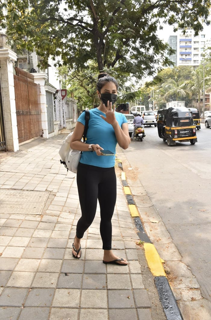 Kim Sharma waved at the shutterbugs as she was photographed outside a clinic in Bandra.