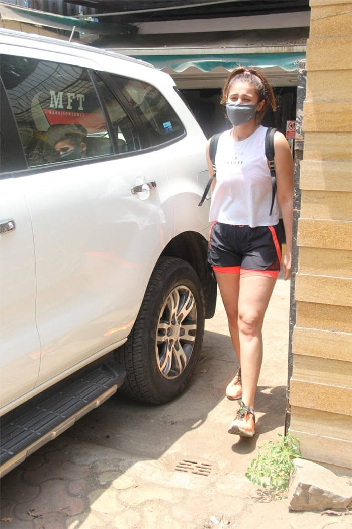 Dhvani kept her gym look simple in a white sleeveless T-shirt and grey shorts.