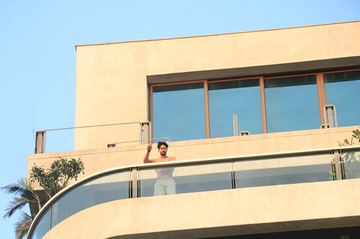 Tiger Shroff posed shirtless in his balcony for the shutterbugs.