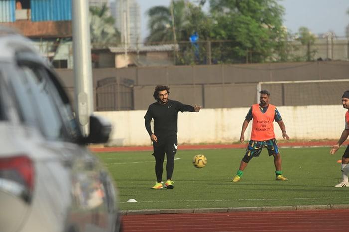 Arjun Kapoor was photographed playing football.