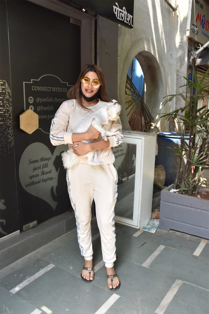 Another former Bigg Boss contestant Nikki Tamboli was photographed with her pet dog outside a clinic in Andheri.