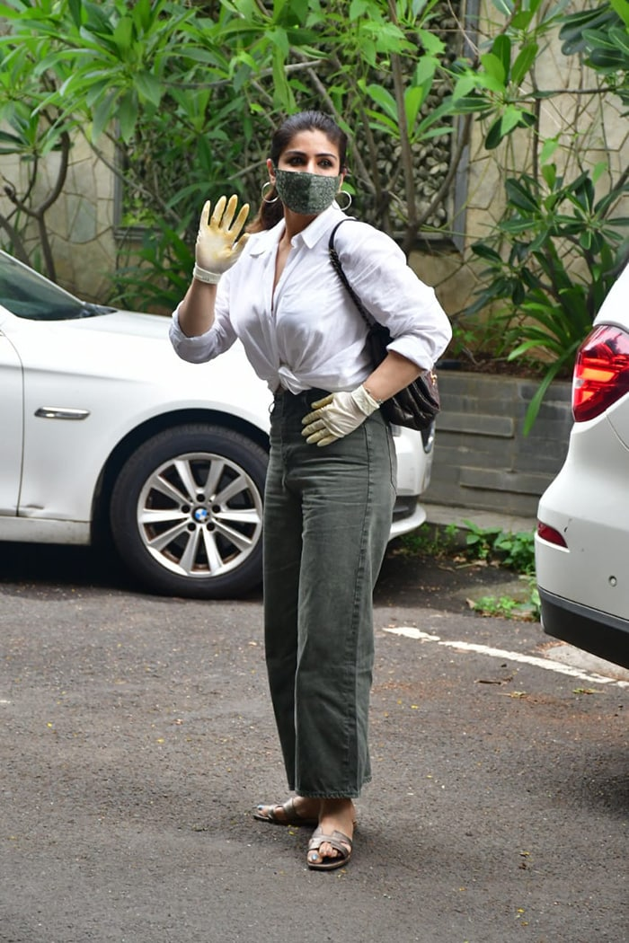 Raveena Tandon waved at the shutterbugs as she was photographed in Bandra.