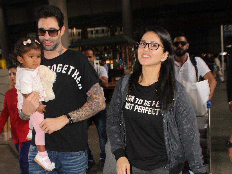 Photo : बेटी के साथ एयरपोर्ट पर दिखीं सनी लियोन