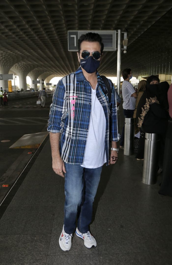 Sanjay Kapoor was also photographed at the airport.