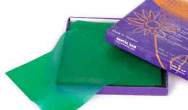 Dental dams are rectangular squares of latex that are used during oral sex, both oral-vaginal and oral-anal. During sex, latex dams are stretched across your partners genitals to prevent your tongue from touching your partners bodily secretions. They are effective method of disease prevention, but can be difficult to hold in place.