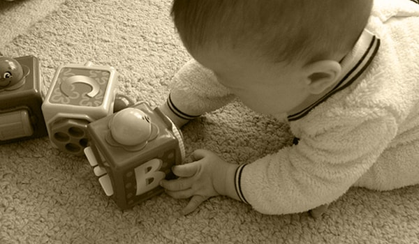 The baby will start understanding simple words and playing and try to attract your attention by making little sounds.