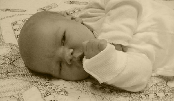 A newborn baby can focus on your face and recognise it and try to distinguish your voice from all others.