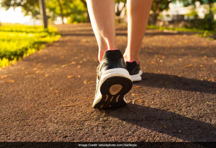 Walk as much as possible. Whenever you are walking try to focus on long strides and quicker than normal pace.