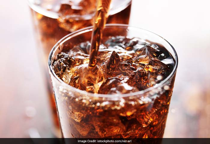 Soft drinks are an easy route through which calories sneak into your body. Avoid these sugary drinks and have more water instead.