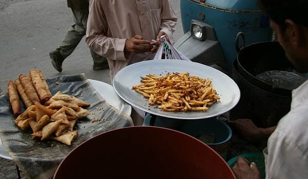 Buying food from roadside vendors should be avoided. Foods at roadside are generally cooked and served under unhygienic conditions or food stored under such conditions for several hours.