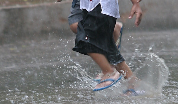 Avoid walking in dirty rain water and keep your shoes and socks dry and clean.