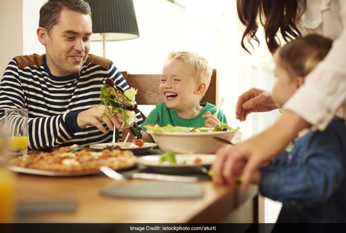 Make meal times enjoyable and talk about what the child is doing.