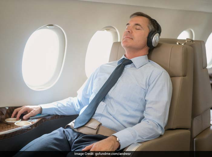 To prevent dizziness while travelling, keep your head still, while resting against a seat back.