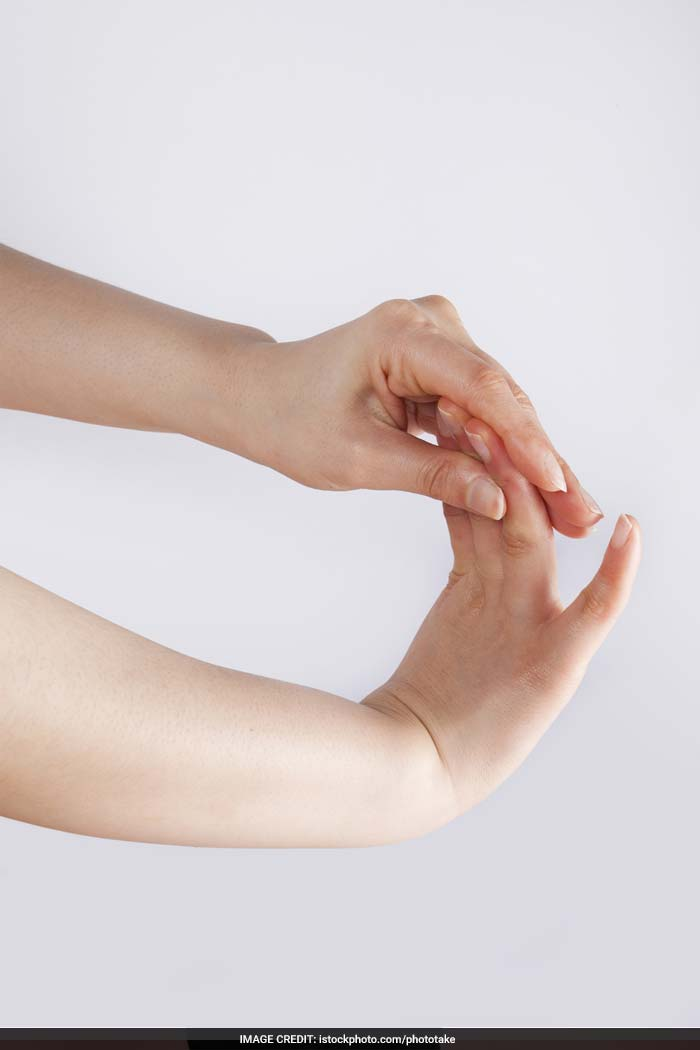 Wrist Stretch: Extend your right arm. Place your left hand under the right forearm. Spread the fingers of your right hand comfortably. Next, you can stretch your wrist up and down and in a clockwise and anticlockwise direction.