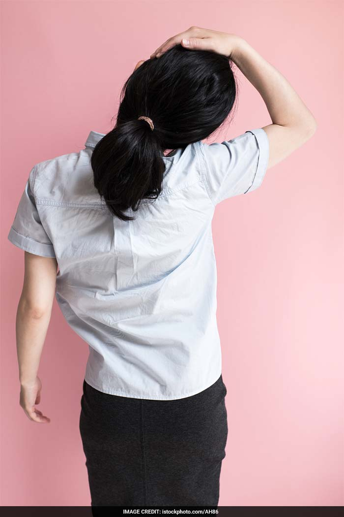Stand in front of your chair with your feet apart and shoulders level. Get your shoulders in a round position, lifting alternate shoulders to your ear, push shoulders back and forwards.