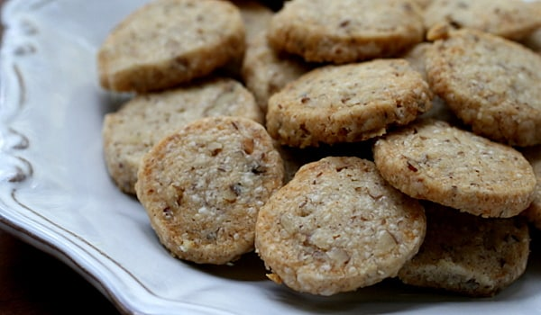 Keep biscuits handy to eat before getting out of bed. Eating foods that contain carbohydrates, such as biscuits or a slice of dry toast after getting up in the morning helps minimise nausea.