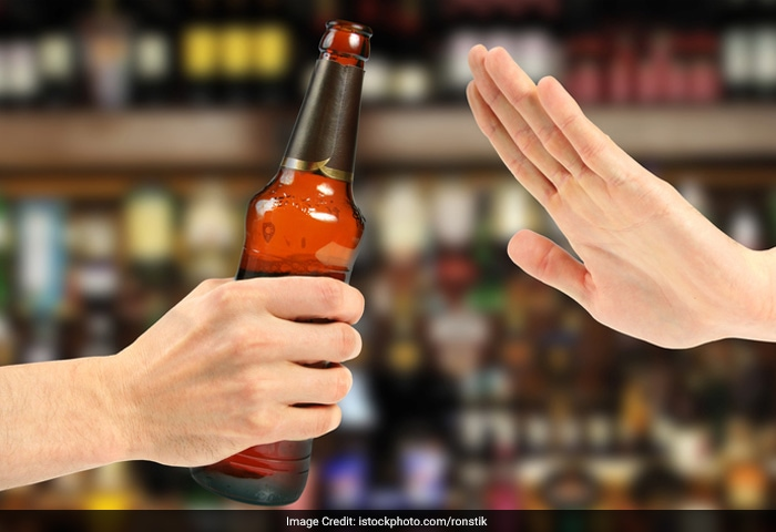 Avoid drinking alcohol at least four hours before bedtime, and let the doctor know about your snoring before taking sedatives or hypnotics. Sedatives and hypnotics (sleeping pills) and alcohol depress the central nervous system, causing excessive relaxation of muscles, including the tissues in your throat.