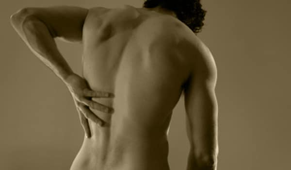 Stretch the neck, back and stomach muscles to prevent back injuries and pain. Use head and shoulder rolls to prevent neck sprains.