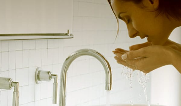 Wash your face with water twice or thrice daily to keep the skin clean and cool. It will also keep your skin oil free and will prevent acne too.