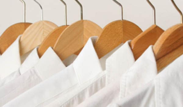 Starching prevents the shirts from sticking to your body, which in turn keeps the body cool because the space inside allows for circulation of air.