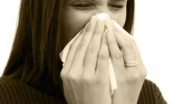 Cover your nose and mouth with a tissue when you cough or sneeze. Throw the tissue in the trash after you use it.