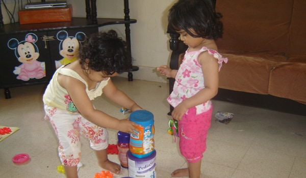 It is important to encourage individuality. As the children become older, try choosing different toys and encourage sharing. Build a special one-to-one relationship with each child. Look for special talents and praise them often. Twins usually have a special bond between them. Try to rear them as individuals without destroying their special bond.  Each twin should be encouraged to have his own friend
