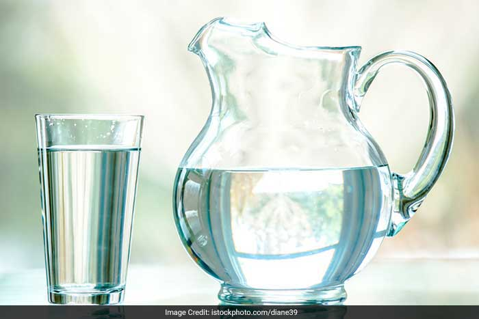 Drink at least 8-10 glasses of water a day. It helps hydrate the skin and also removes impurities from the body.