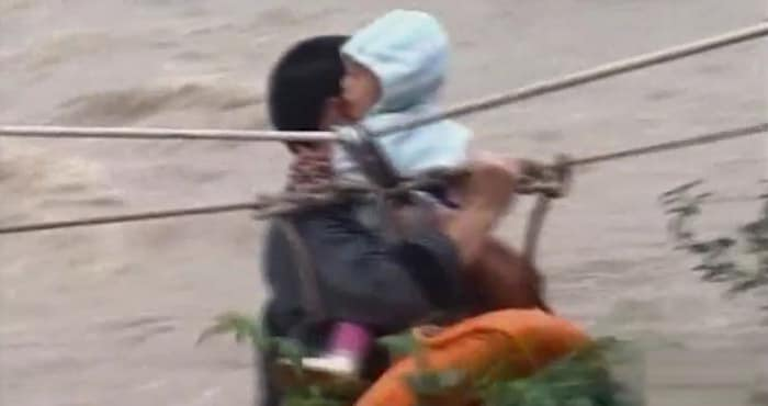 China: Baby rescued from flood water