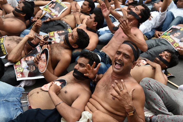 5 Pics: Angry and Shirtless, Congress Workers Protest Against BJP