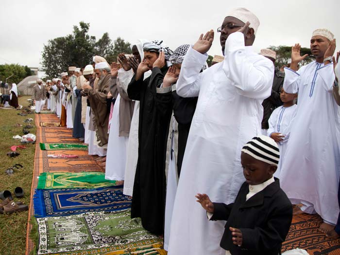 Muslims celebrate Eid with prayers, feasts across the world