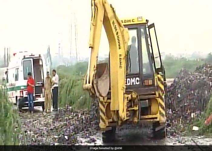 Pics: People Trapped After Ghazipur Landfill Collapses