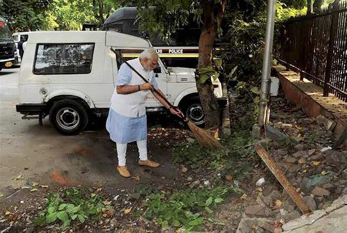 The PM and a Broom. Clean India Mission Launched.